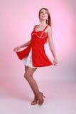 Мечтательная девушка в красном платье Стоковая Фотография RF