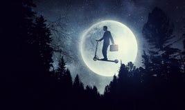 Мечта ночи бизнесмена Мультимедиа стоковые изображения rf