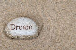 Мечта слова на камне пляжа Стоковые Фотографии RF