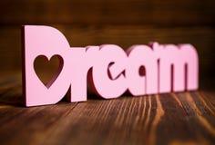 Мечт письма на деревянной предпосылке Стоковое Фото