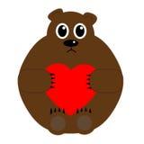 Медведь держа день валентинок сердца Стоковые Фото