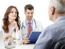 Медицинская бригада с пожилым пациентом Стоковая Фотография RF
