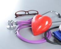 Медицинские инструменты, стетоскоп и красная съемка крупного плана сердца Стоковая Фотография