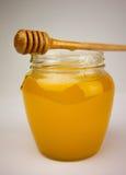 Мед на белизне Стоковая Фотография