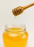 Мед на белизне Стоковые Фотографии RF