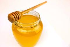 Мед на белизне Стоковые Фото