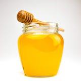 Мед на белизне Стоковые Изображения
