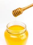 Мед на белизне Стоковое Изображение
