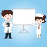 Медсестра и доктор с простой белой доской стоковая фотография rf