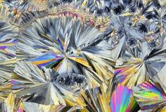 Микроскопический взгляд кристаллов сахарозы в поляризовыванном свете Стоковая Фотография RF
