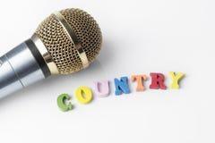 Микрофон на белой предпосылке, конец-вверх Стоковое Изображение RF