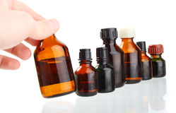 микстура medicament удерживания руки бутылки Стоковая Фотография RF