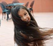 Милая девушка вертясь Стоковая Фотография