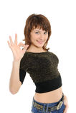 милая девушка давая одобренный знак Стоковое фото RF