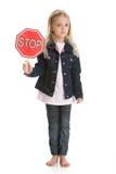 милая девушка держа меньший стоп знака белым Стоковые Фотографии RF