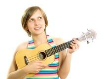 милая девушка играя ukulele стоковое изображение rf