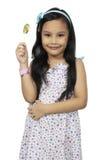 Милая девушка и конфета стоковые фотографии rf