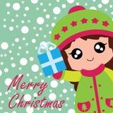 Милая девушка приносит подарок коробки Xmas соответствующий для рождественской открытки Стоковые Фотографии RF