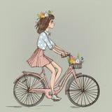 Милая девушка шаржа на велосипеде бесплатная иллюстрация