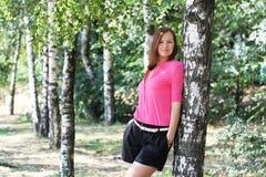 Милая женщина в парке Стоковая Фотография