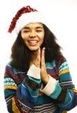 Милая маленькая девочка в изолированной шляпе santas красной Стоковое Изображение RF
