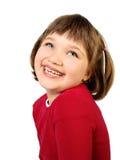 Милая маленькая девочка хихикая Стоковые Фото