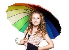 Милая молодая женщина с зонтиком цвета Стоковое Изображение