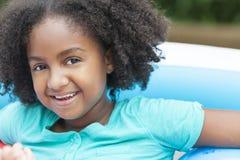 Милая счастливая девушка афроамериканца Стоковые Изображения RF