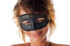Милая усмешка за маской Стоковая Фотография
