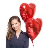 Милое брюнет с баллонами сердца Стоковая Фотография RF