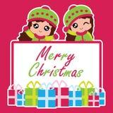 Милые 2 девушки и Xmas кладут подарки в коробку соответствующие для рождественской открытки Стоковая Фотография RF
