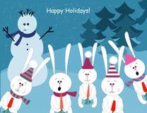 Милые кролики и снеговик Стоковая Фотография