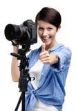 Милый женщин-фотограф фотографирует стоковые изображения rf