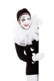 Милый клоун смотрит за углом Стоковая Фотография