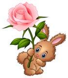 Милый маленький шарж кролика держа цветок иллюстрация штока