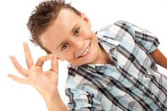 милый малыш делая одобренный знак Стоковые Фото
