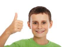 Милый малыш с большими пальцами руки вверх стоковая фотография rf