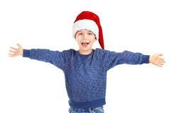 Милый мальчик в шляпе santa Стоковые Фотографии RF