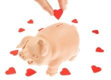 Милый поросенк-piggy банк для собрания сердец. Стоковые Изображения RF