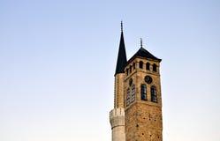 Минарет и башня с часами Стоковая Фотография