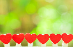 Миниатюрная влюбленность сердца для концепции валентинки Стоковые Изображения RF