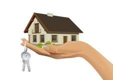 Миниатюрное жилищное строительство в наличии с ключами Стоковая Фотография