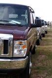 миниые фургоны рядка Стоковые Фотографии RF