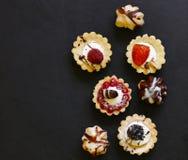 Мини печенья помадки пирогов десерта Стоковые Изображения