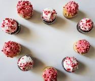 10 мини пирожных в форме сердца Стоковые Изображения RF
