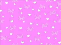 Мини сердце и лента на розовой предпосылке Стоковые Изображения