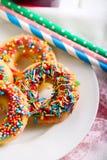 Мини donuts с помадкой брызгают Стоковая Фотография RF