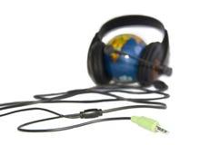 мир глобуса изолированный шлемофоном Стоковые Изображения RF