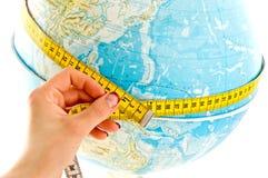 мир ленты глобуса измеряя Стоковые Изображения RF