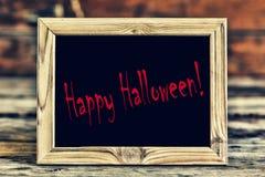 Мистическая рамка с черной предпосылкой с надписью счастливым хеллоуином Стоковая Фотография